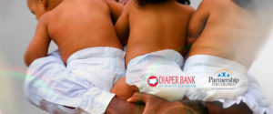 African-American dad hold triplets wearing diapers