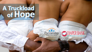 A Truckload of Hope logo over image of father holding triplets.