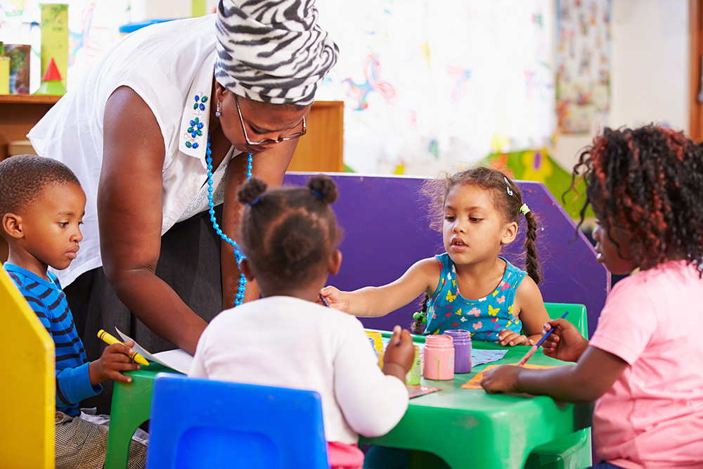 Teacher with children in Pre-K classroom
