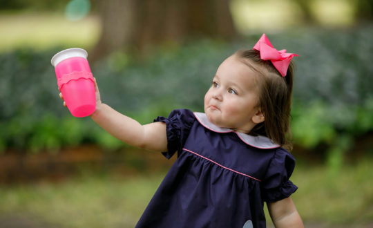 Young girl with sippy cup